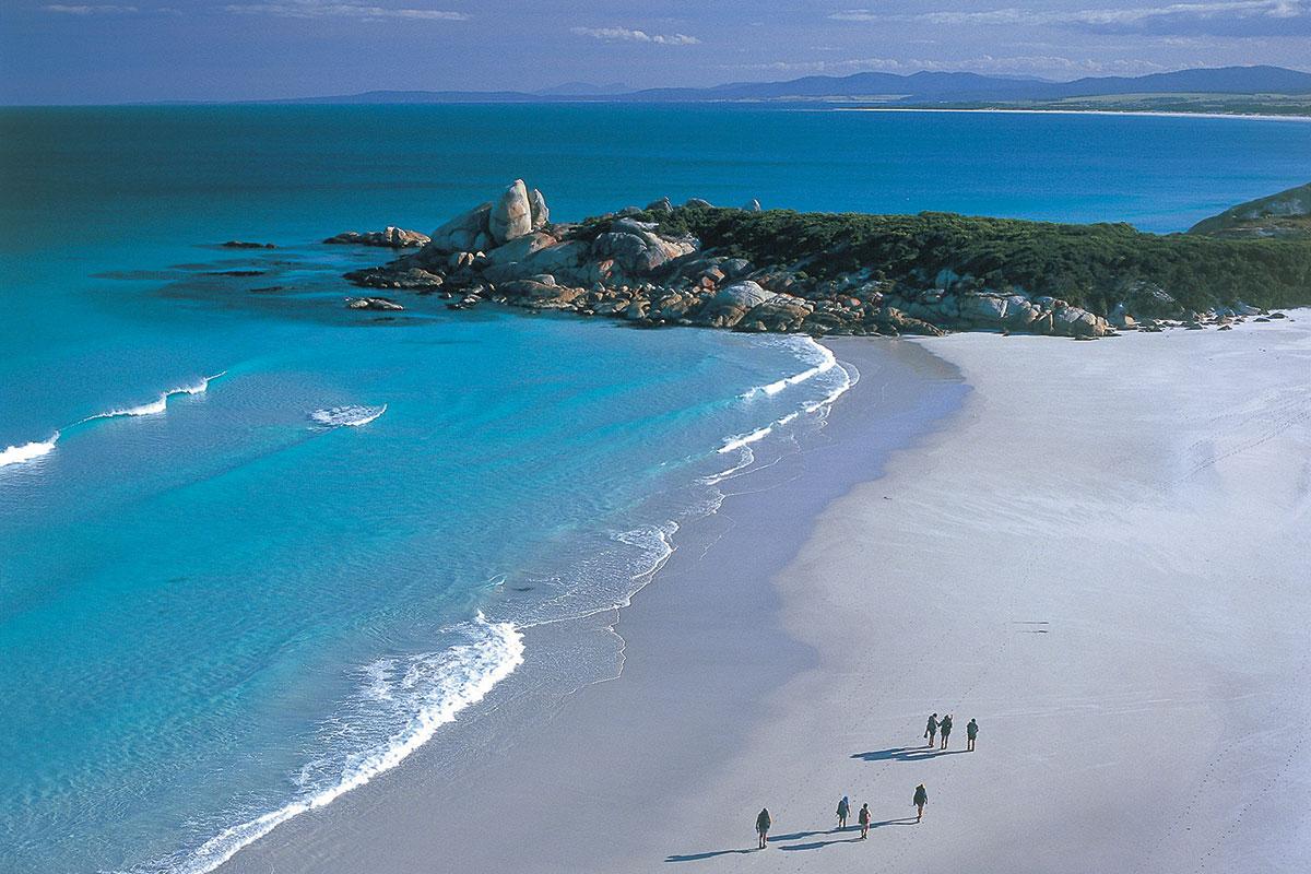 Walk along pristine, white sand beaches on the Bay of Fires Lodge Walk in Tasmania.