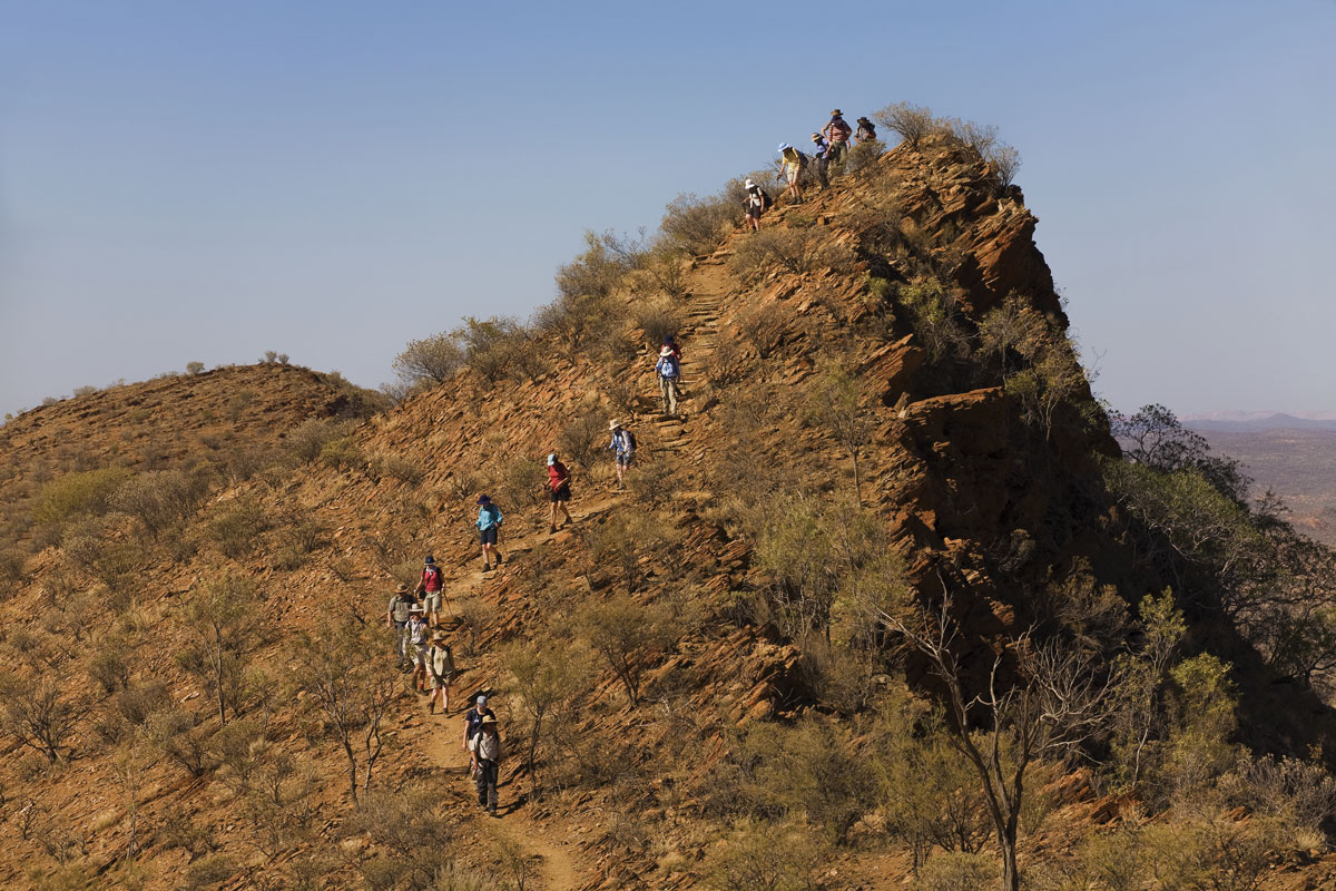 Hike over high ridgelines in the hills along the Larapinta Trail in the Northern Territory.