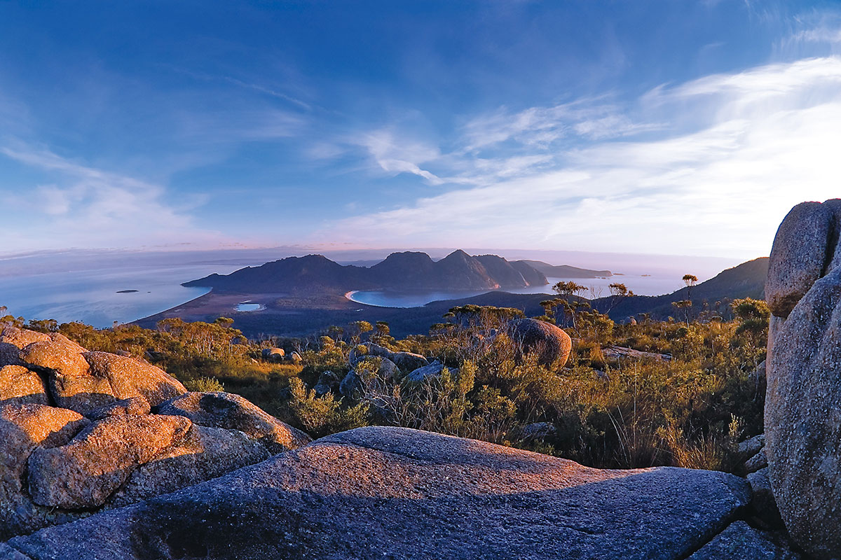 Take in magnificent views of Wineglass Bay and Hazard Mountains in Tasmania.