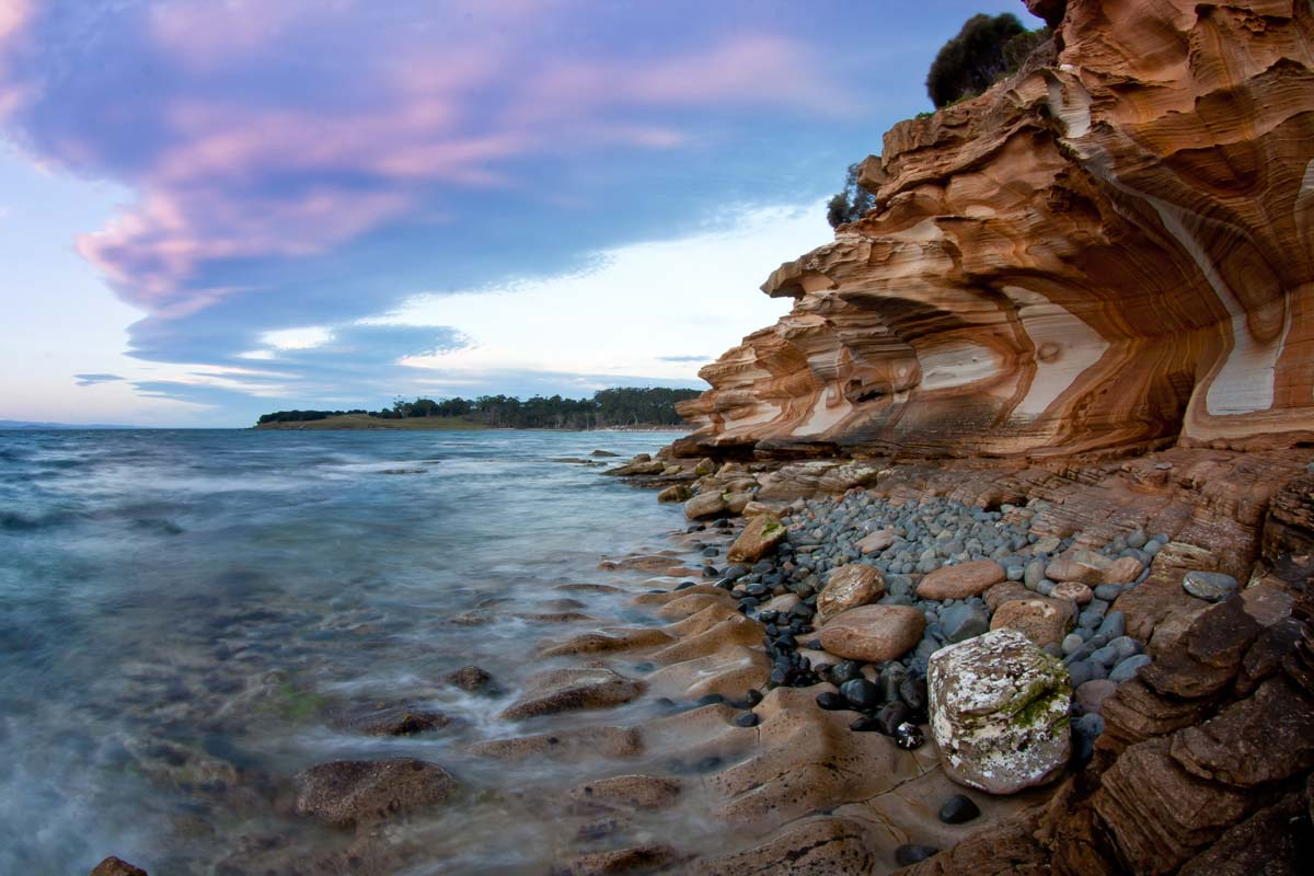 Experience the awe-inspiring Painted Cliff on the Maria Island Walk in Tasmania.